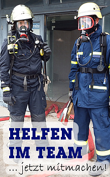 Feuerwehrmann und THW Helfer unter Atemschutz